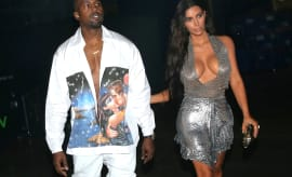 Kanye in a Prada shirt with Kim in Miami