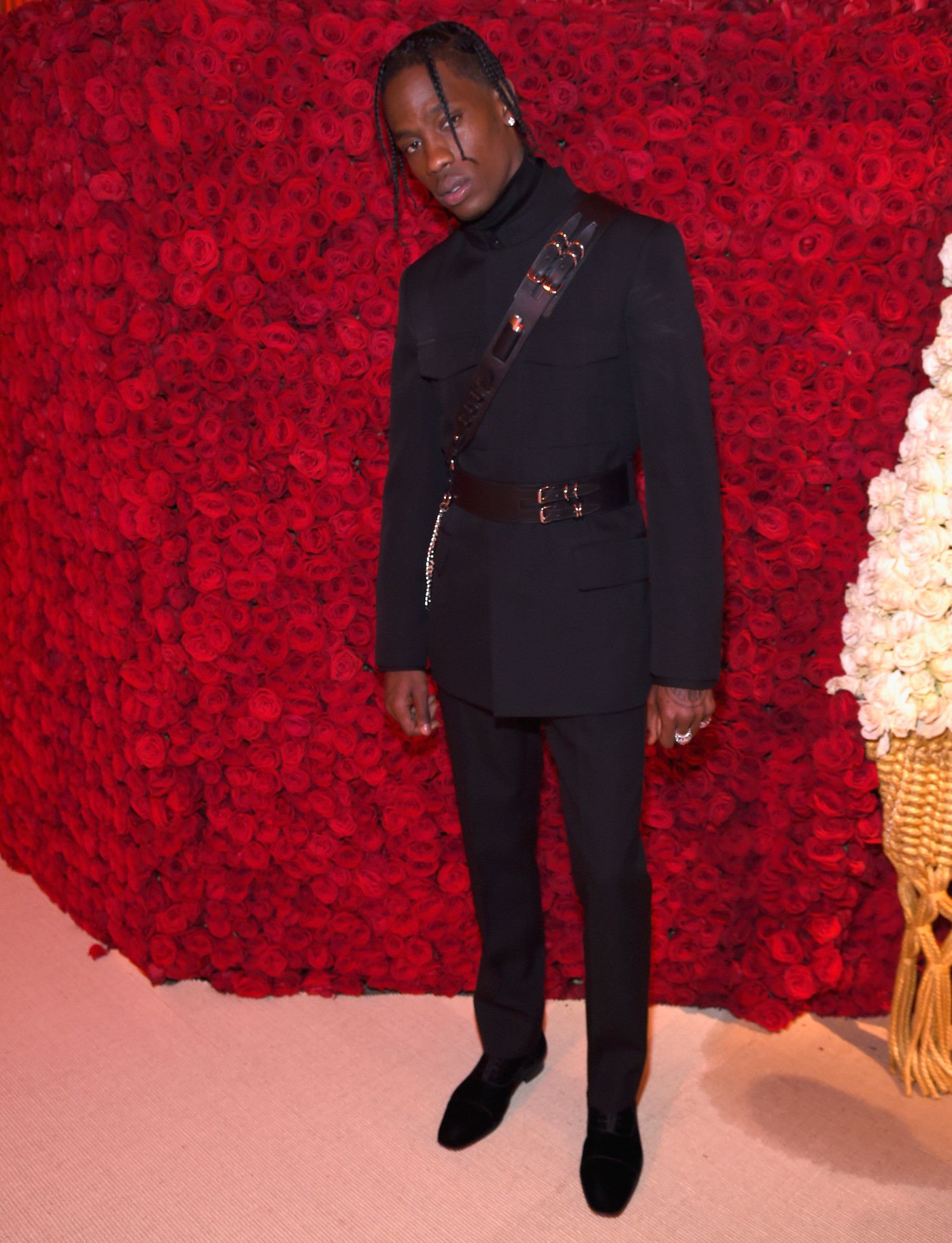 ic: Travis Scott's suave formalwear, accessorized with leather harnesses, pictured at the Met Gala 2018. Image via Getty/Kevin Mazur/MG18