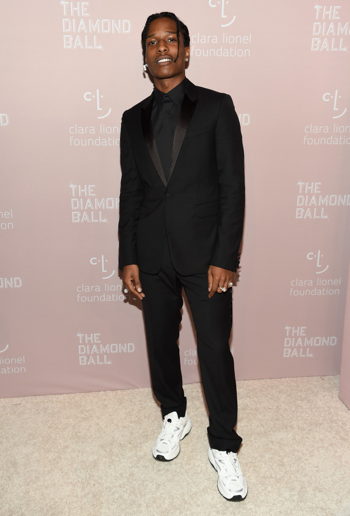 bb0341e1a ASAP Rocky wearing Berluti suit to Rihanna's Diamond Ball 2018.