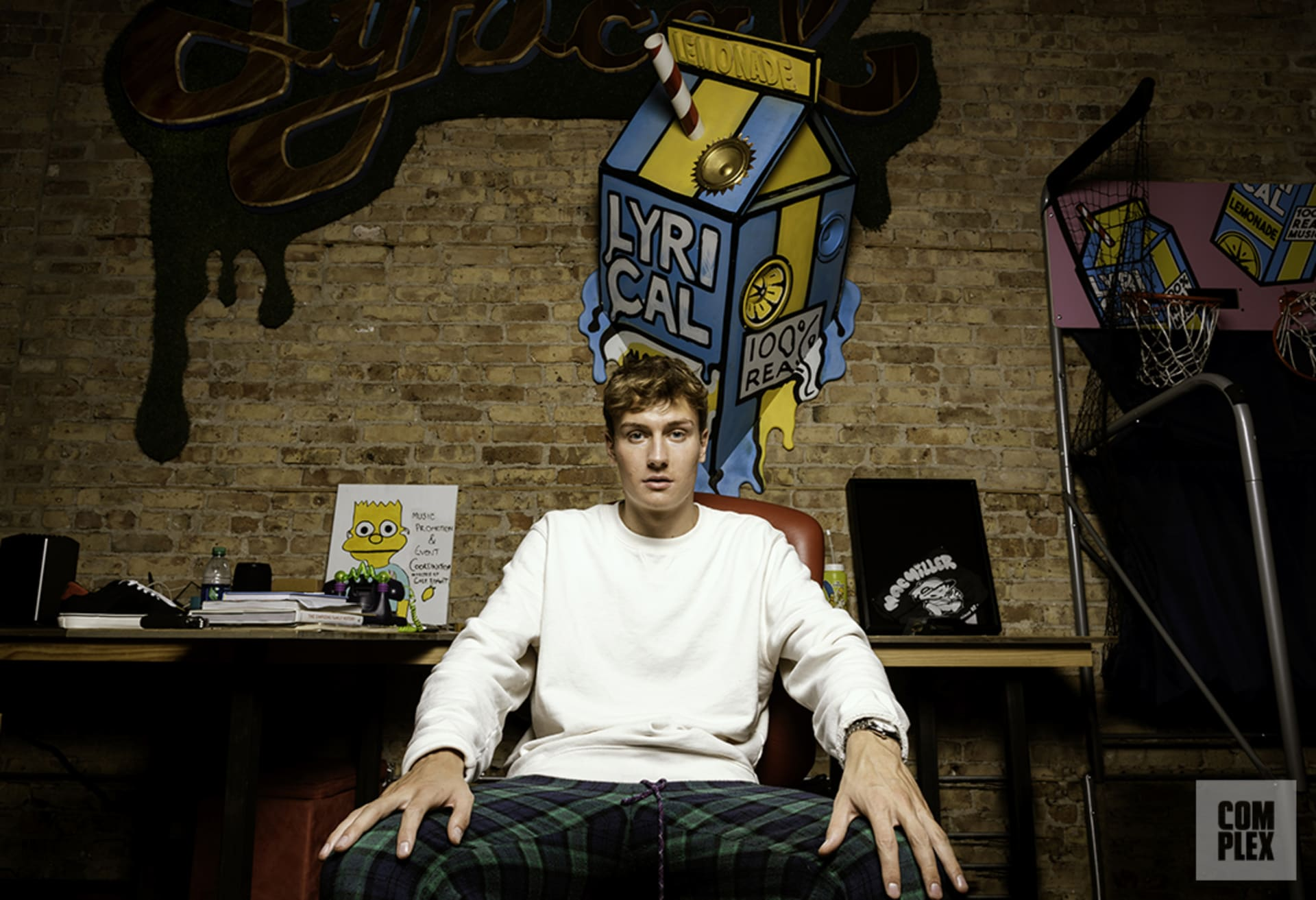 Cole Bennett poses for his Complex interview at his Lyrical Lemonade office in Chicago.