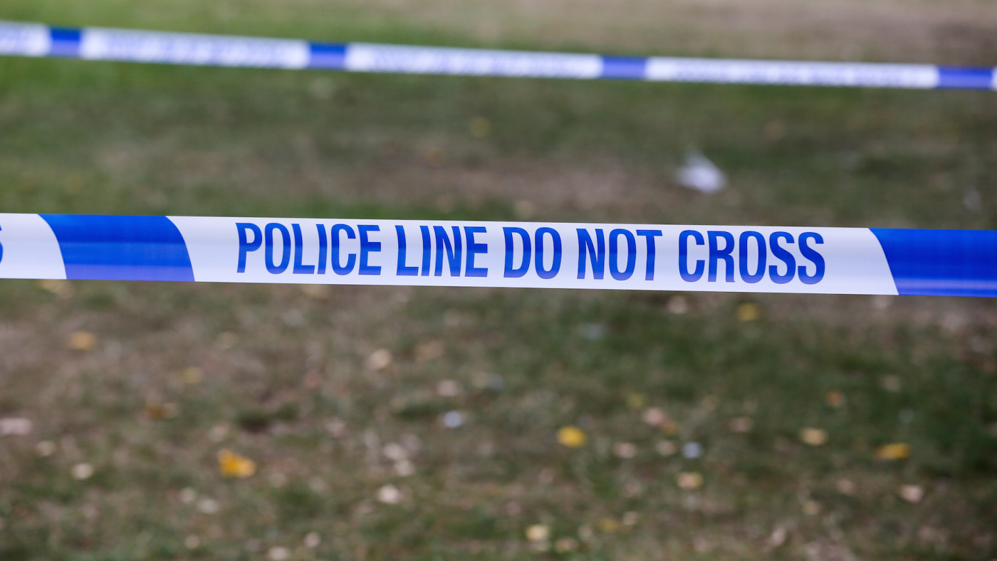 Police tape with 'Police Line Do Not Cross' written on it