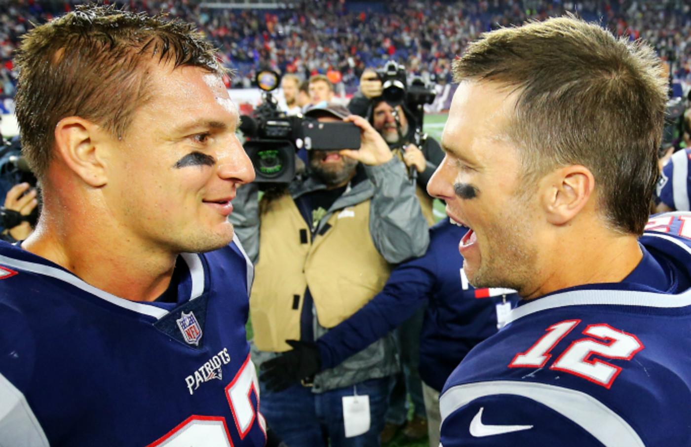 Tom Brady #12 talks to Rob Gronkowski #87 of the New England Patriots
