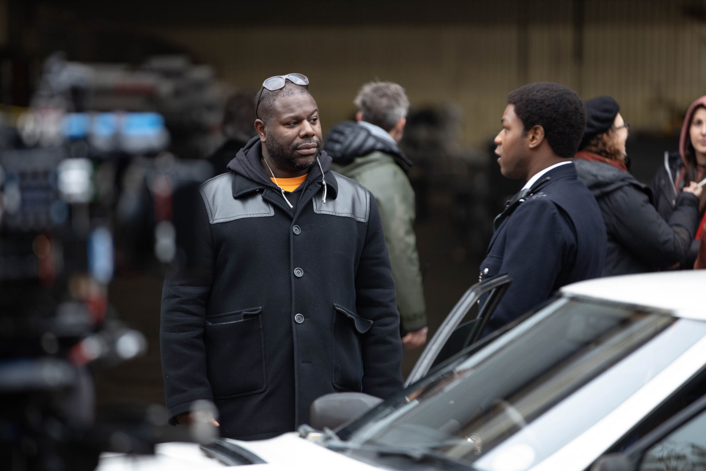 Director Steve McQueen and John Boyega as Leroy Logan on the set of Red, White and Blue.