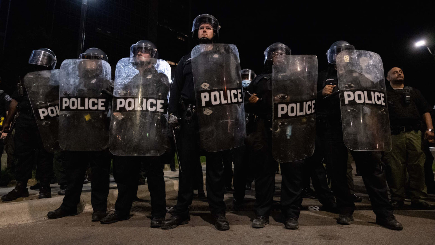 Detroit Police officers watch demonstrators in the city of Detroit, Michigan