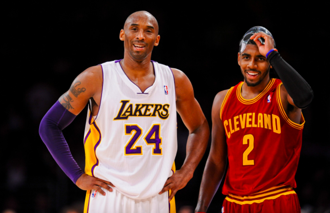 Kobe Bryant #24 of the Los Angeles Lakers and Kyrie Irving