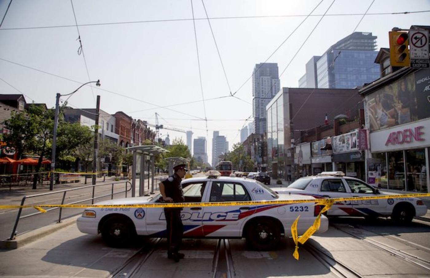 Toronto police at the scene where Smoke Dawg was shot.