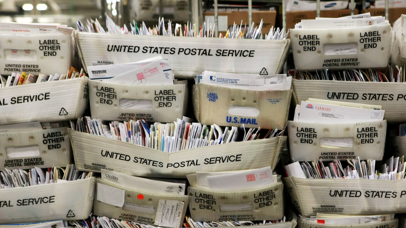 Stacks of boxes holding cards and letters are seen at the U.S. Post Office sort center.