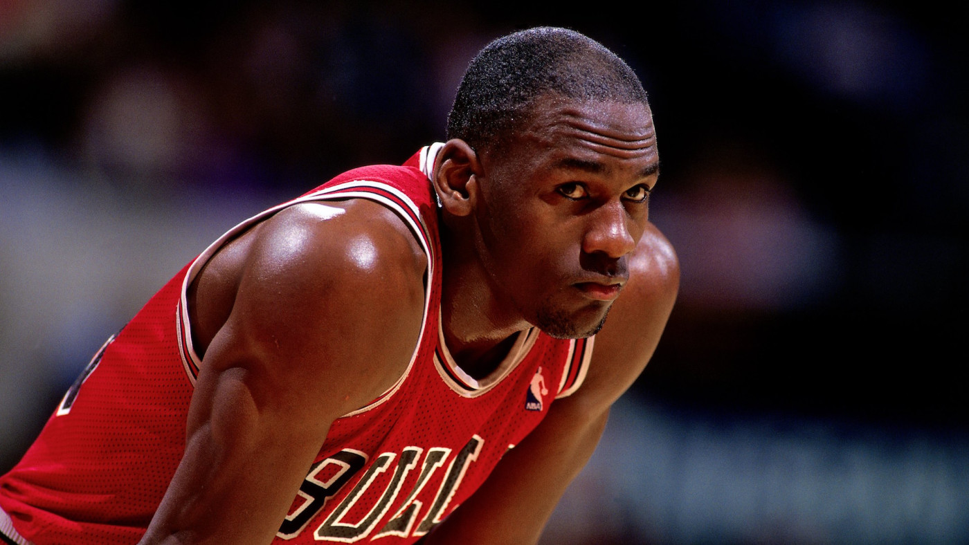 Michael Jordan #23 of the Chicago Bulls looks on durng a NBA game.