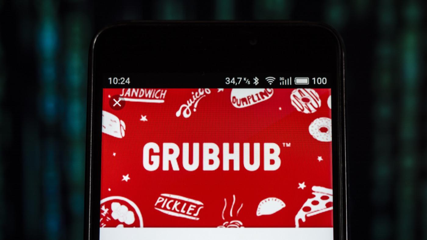 On this photo illustration, the GrubHub logo