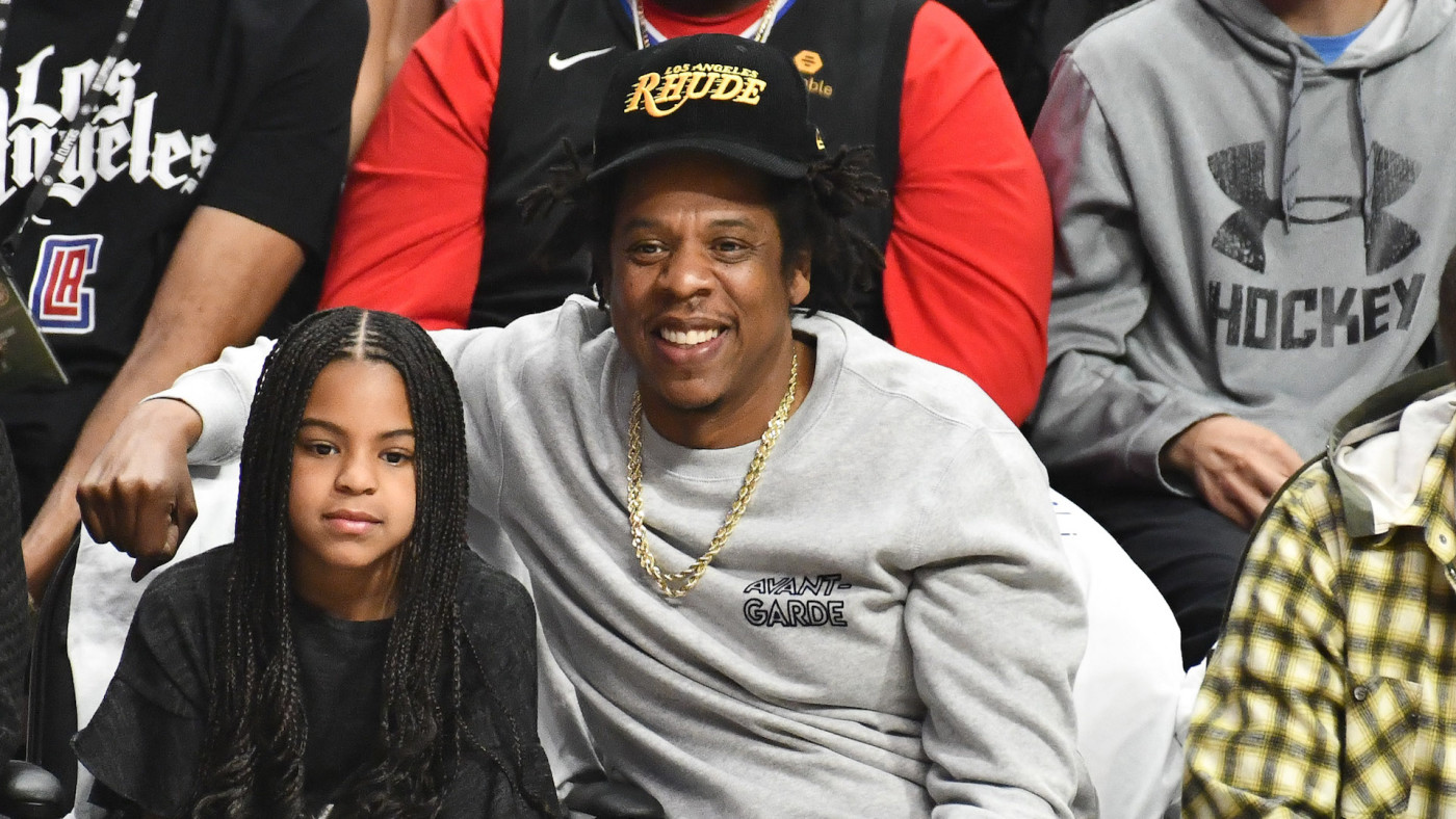 ay-Z and Blue Ivy Carter attend a basketball game