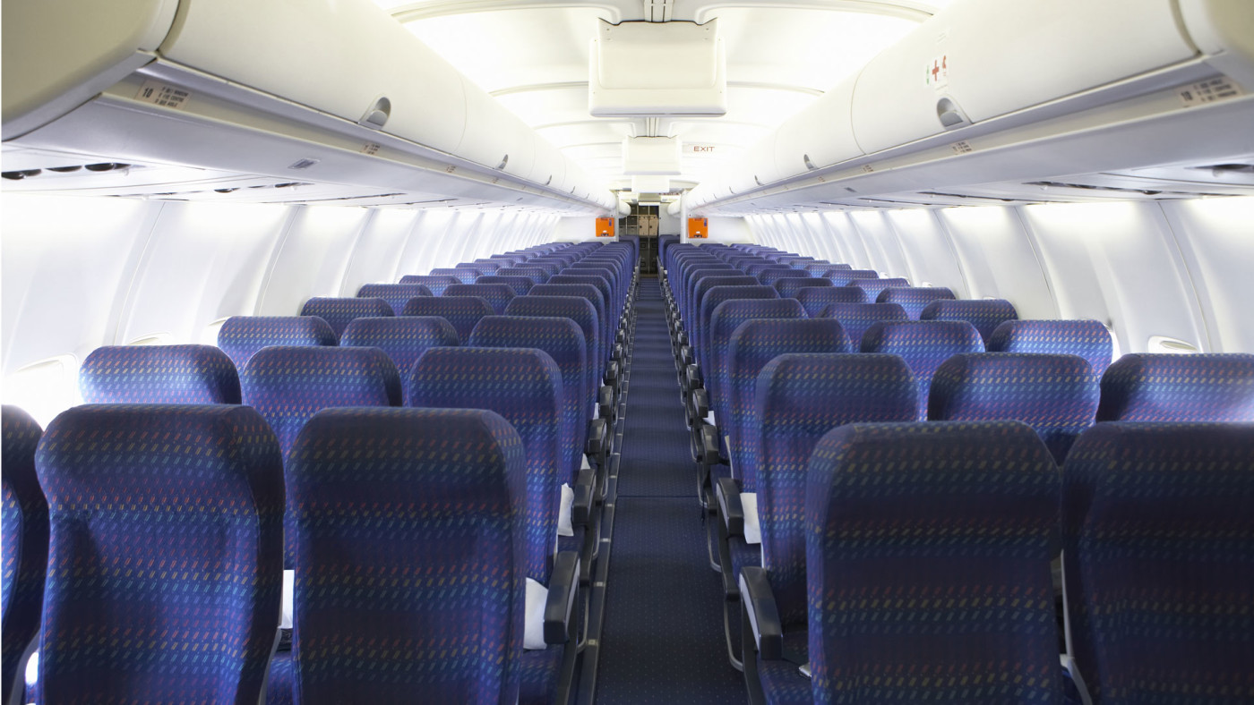 Rows of airplane seats.