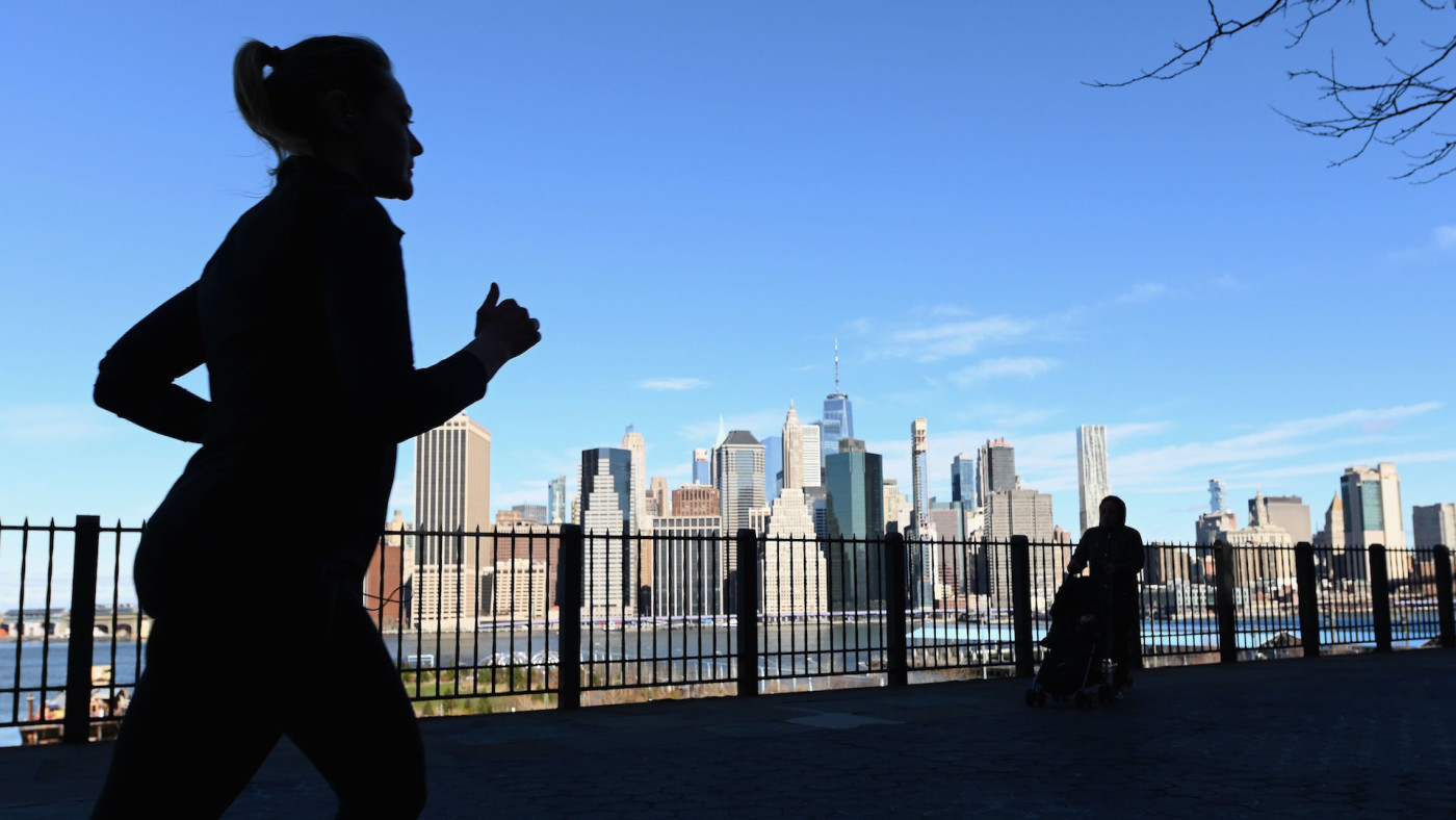 A woman jogs along the Brooklyn Heights promenade.