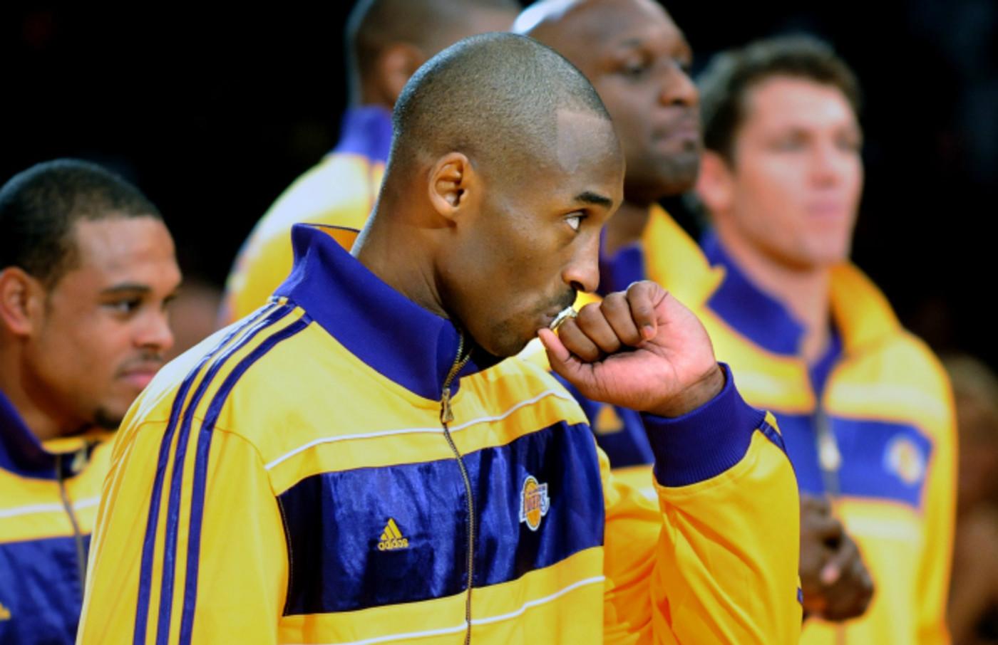 Lakers Kobe Bryant kisses his championship ring