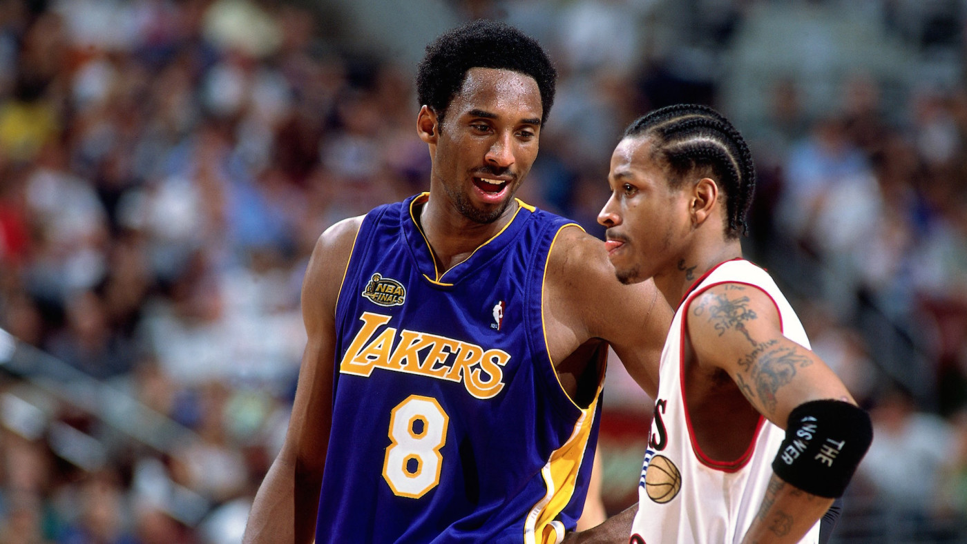Kobe Bryant #8 of the Los Angeles Lakers chats with Allen Iverson