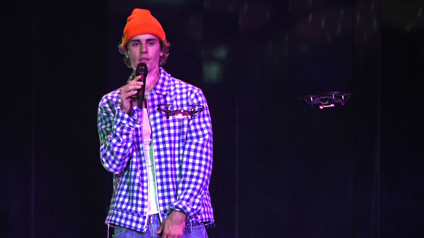 Justin Bieber performs onstage at the 2020 American Music Awards.