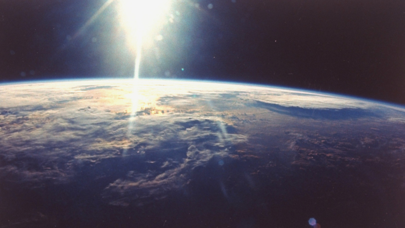 View of sunlight over Earth taken from space shuttle Discovery VIII mission.