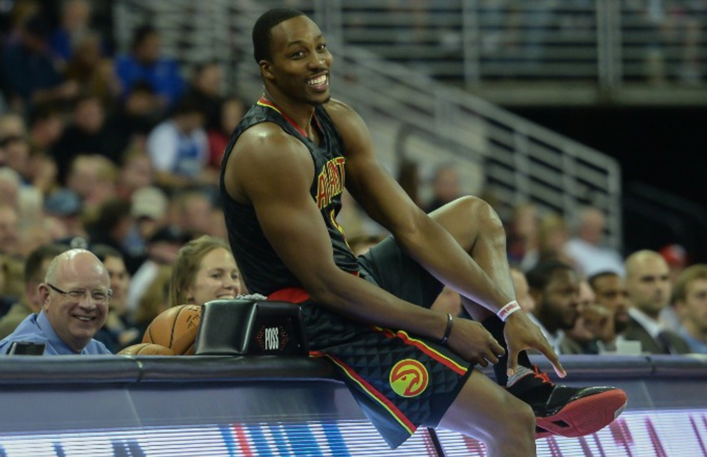 Dwight Howard prepares to check in to a game for the Hawks.