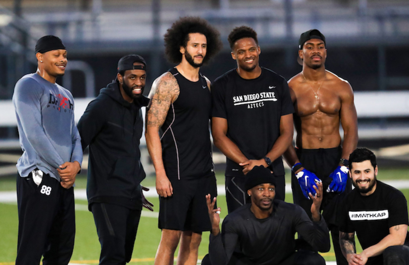 Colin Kaepernick stands with Jordan Veasy, among others. during NFL workout