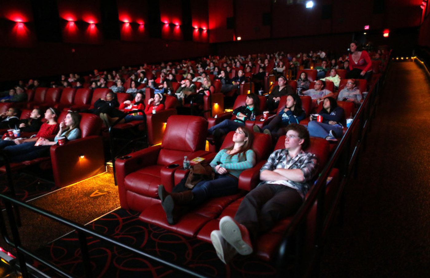 People relax in all powered recliner seats at AMC Movie Theater.