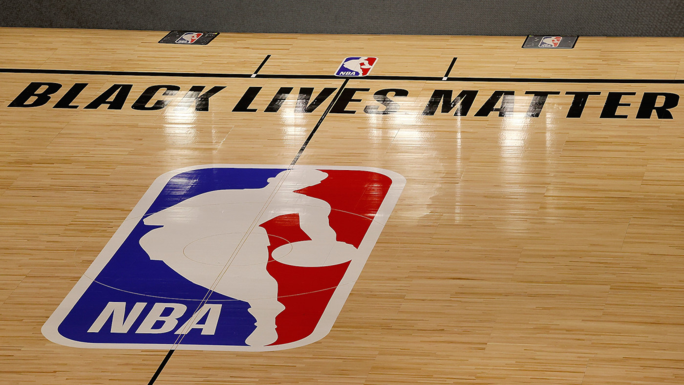 The Black Lives Matter logo is seen on an empty court