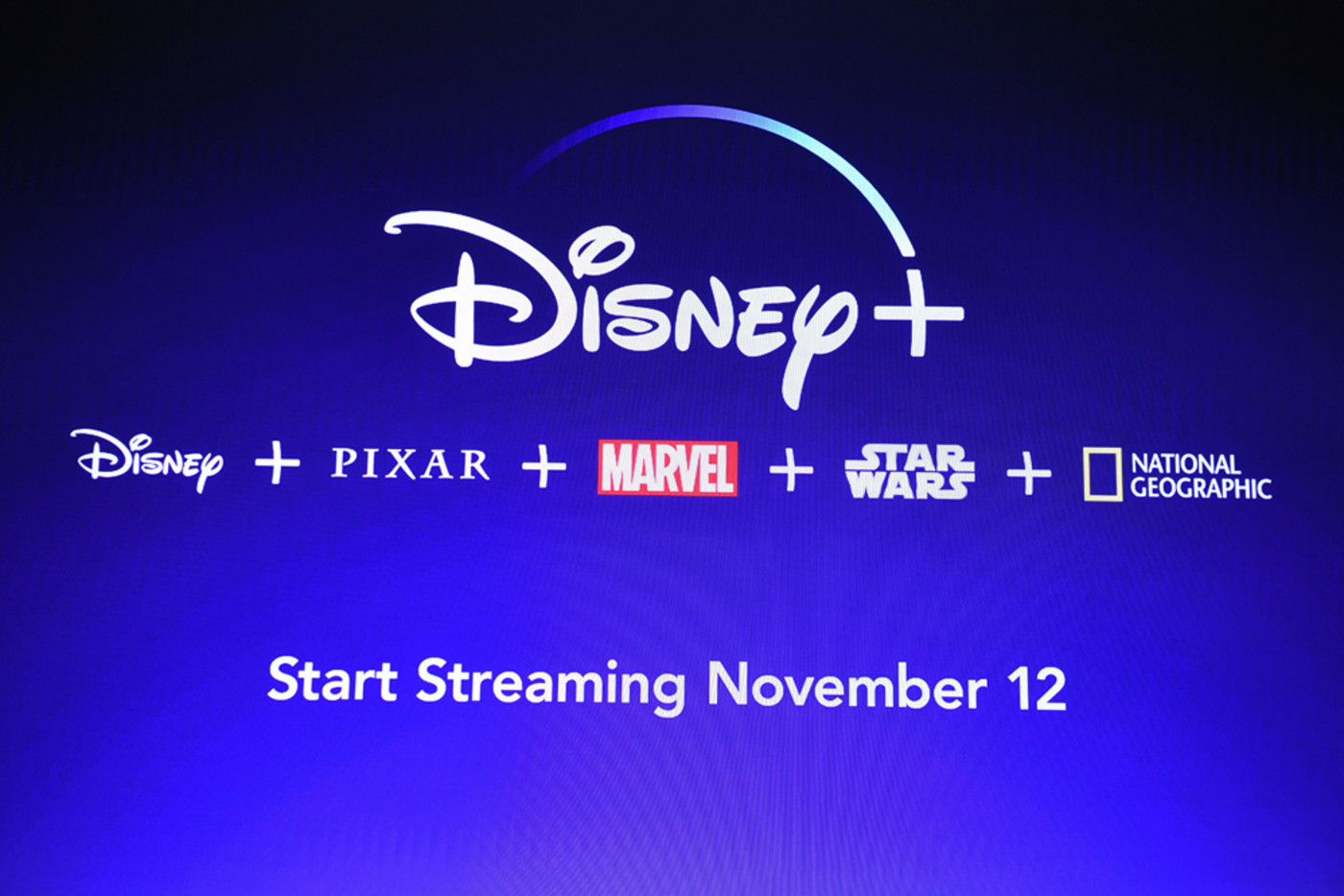 A screen announcing the Disney+ streaming service is seen at the D23 Expo