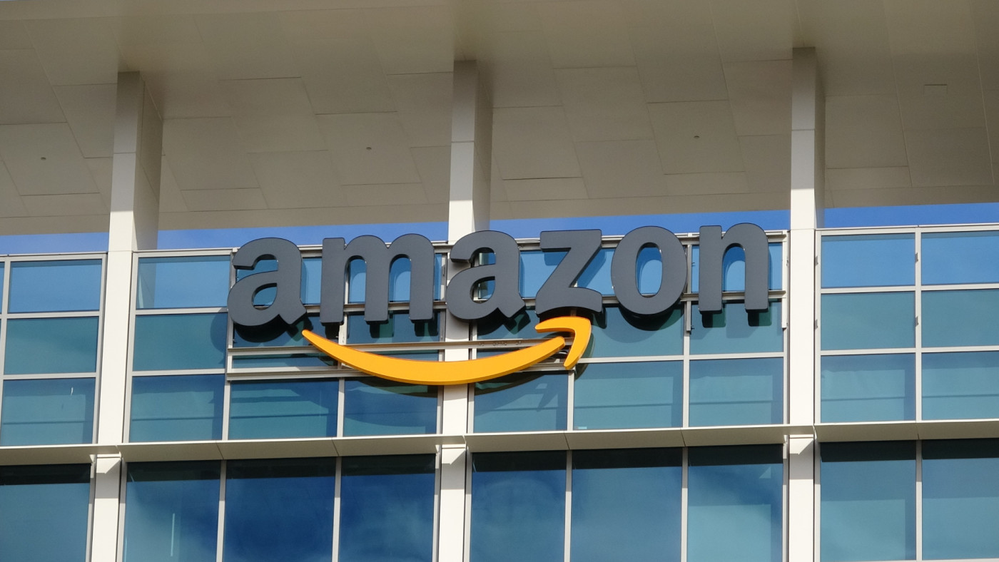 Sign with logo on facade of the regional headquarters of ecommerce company Amazon.