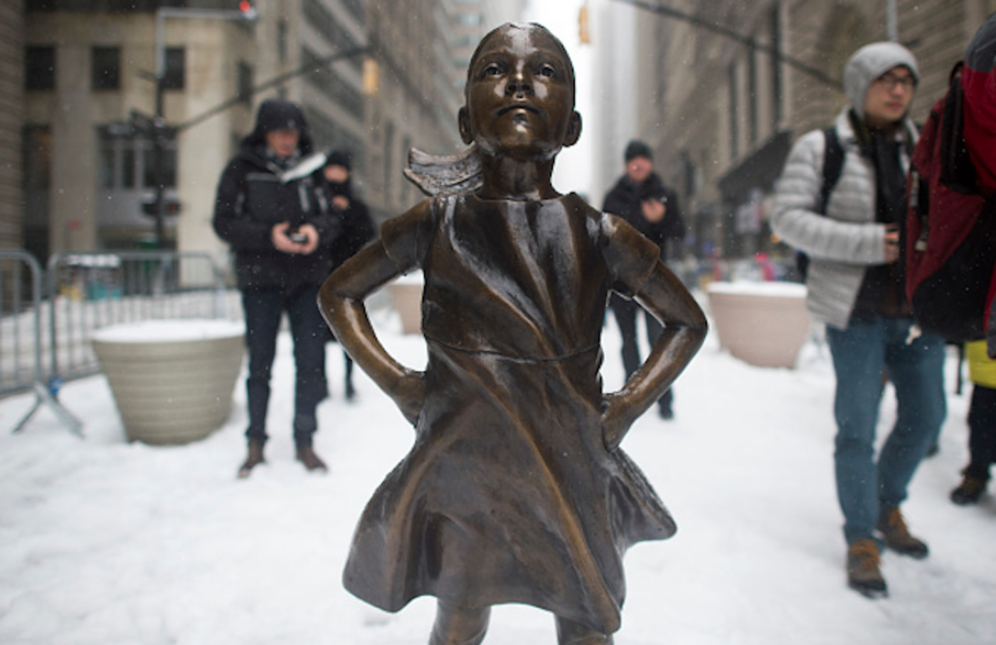 The Fearless Girl statue stands in the snow