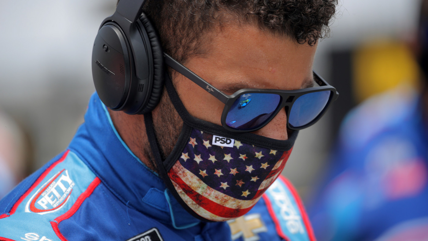 Bubba Wallace stands on the grid prior to the NASCAR Cup Series GEICO 500.