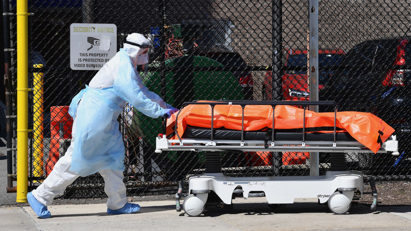 Medical staff move bodies from the Wyckoff Heights Medical Center to a refrigerated truck.