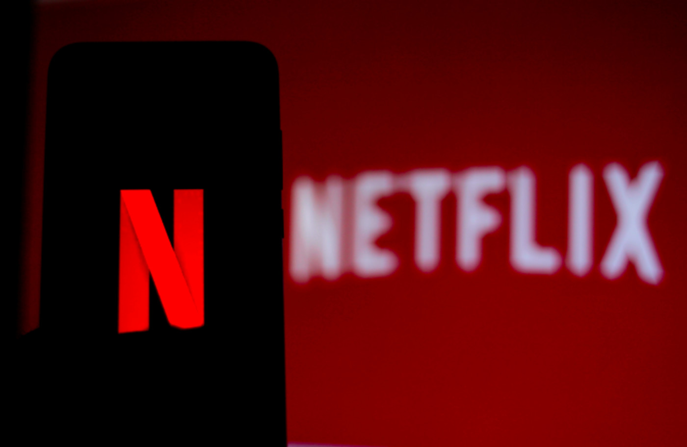 In this photo illustration the Netflix logo