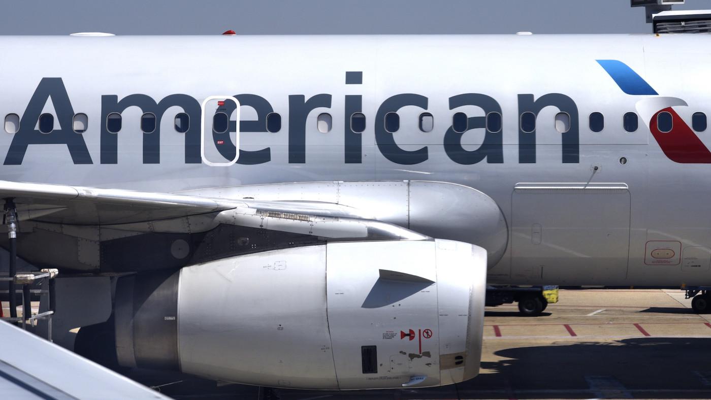 American Airlines passenger aircraft parked at gate at Ronald Reagan Washington National Airport.