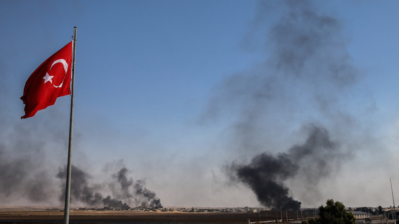 Dark smoke rises at the site of Tell Abyad city of Syria after terrorists burnt tires