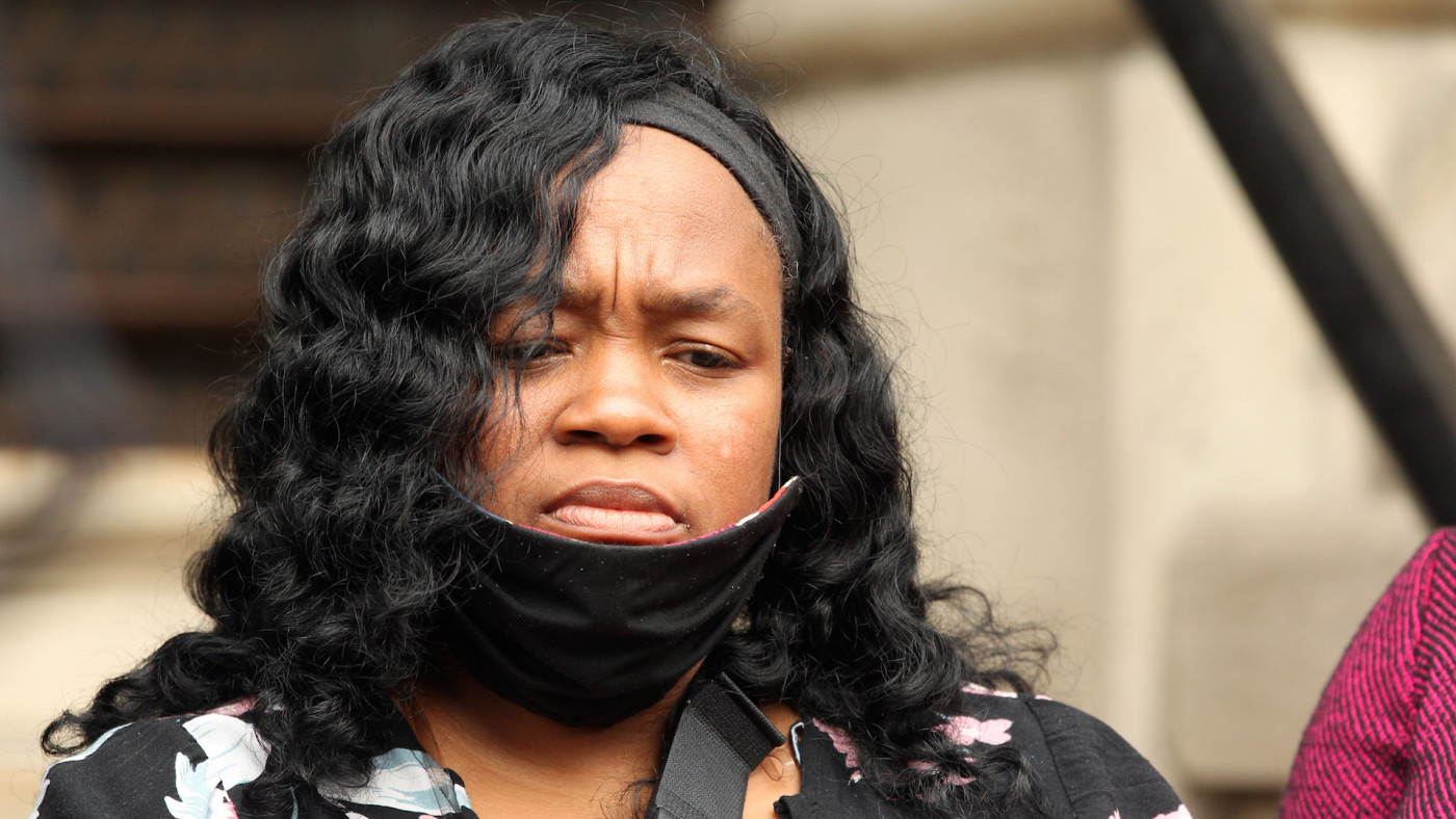 Breonna Taylor's mother Tamika Palmer listens during a press conference