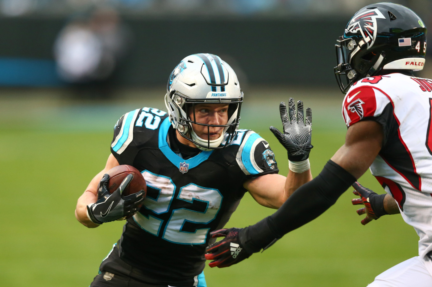 Christian McCaffrey Stiff Arm Panther Falcons 2018