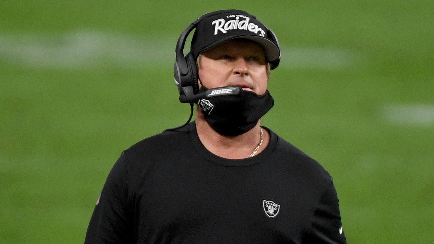 Jon Gruden wears a protective face mask incorrectly on the sideline against the Bills.