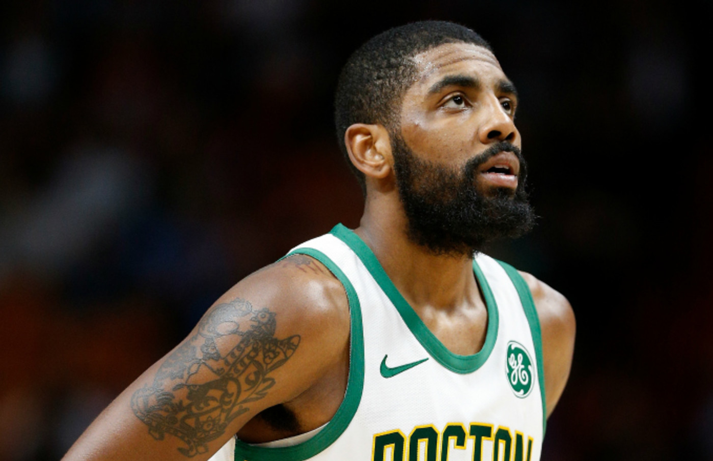 Kyrie Irving #11 of the Boston Celtics in action against the Miami Heat