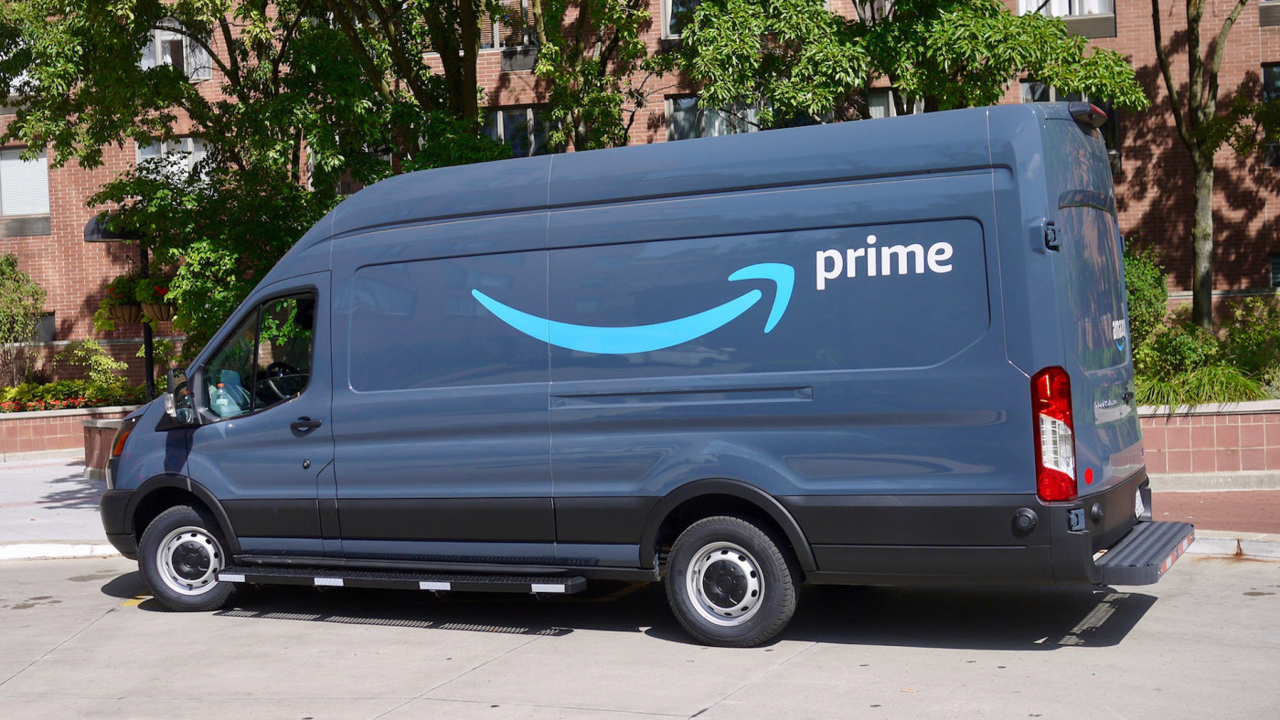 View of an Amazon delivery van parked at an apartment complex in Chicago.