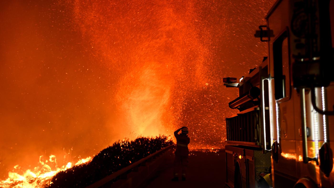 California firefighter watching fire tornado.