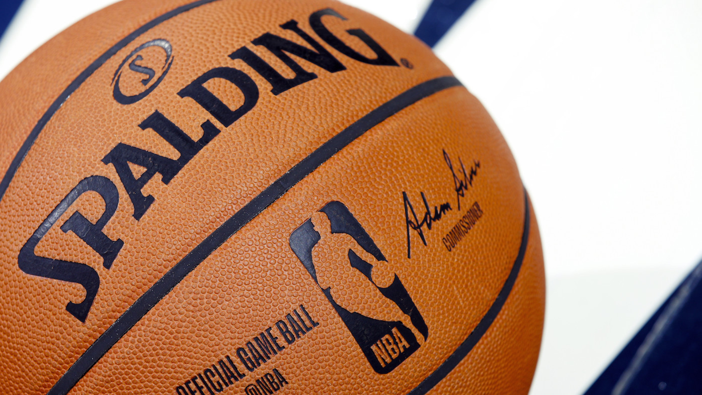 A detail view of official Spalding NBA logo basketball on the floor.