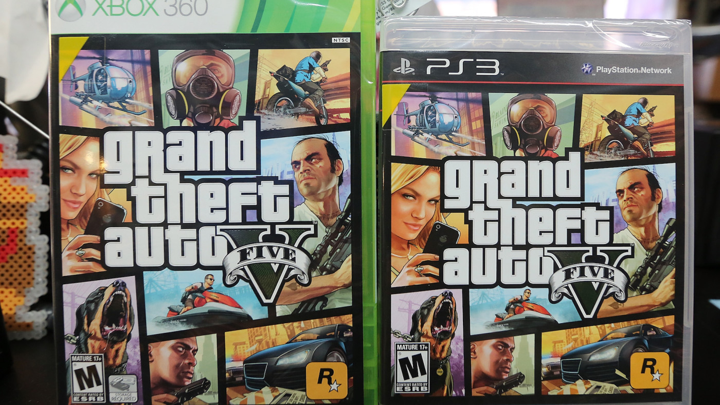 Copies of Grand Theft Auto V are displayed at the 8 Bit & Up video games shop.