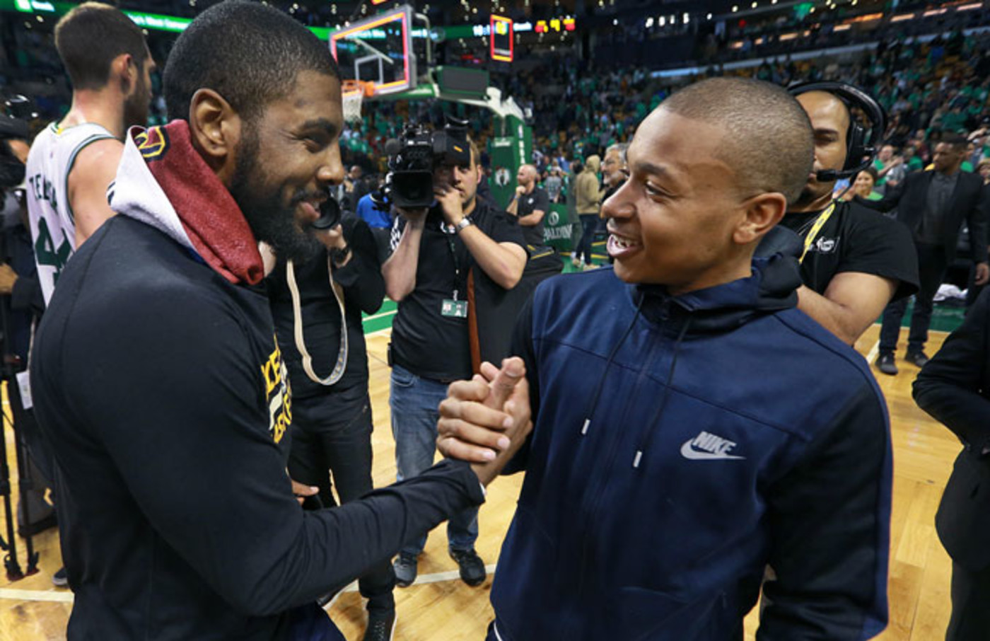 Kyrie Irving and Isaiah Thomas exchange a handshake.
