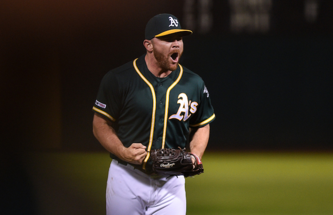 Liam Hendriks celebrates after recording the final out in the ninth inning.