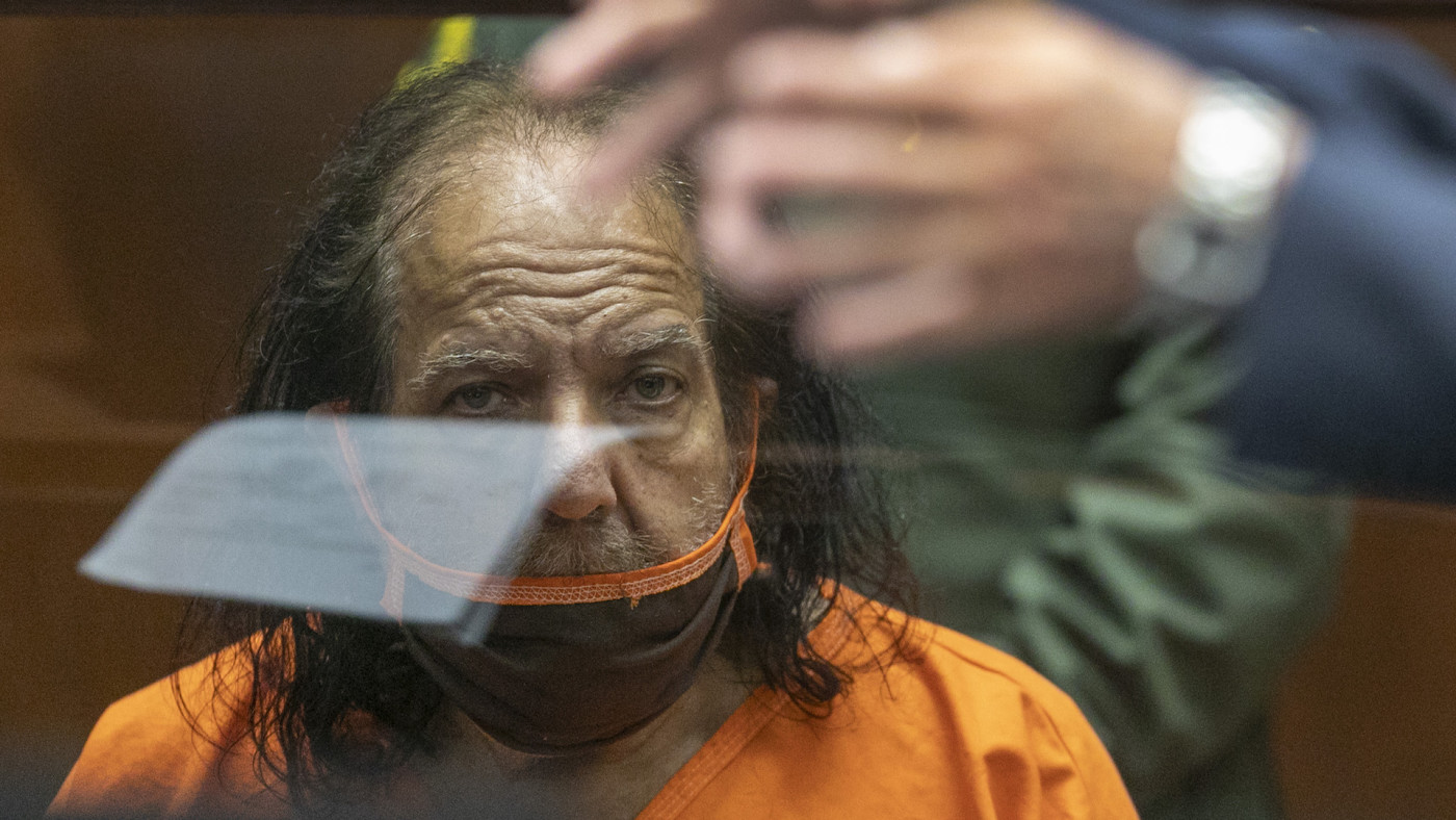 Ron Jeremy listens as his attorney Stuart Goldfarb speaks during his arraignment.