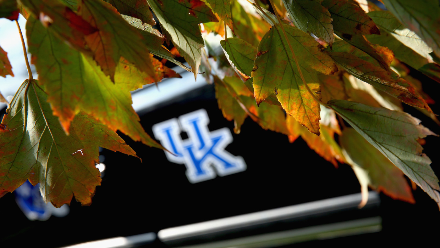 The fall colors frame a University of Kentucky logo.