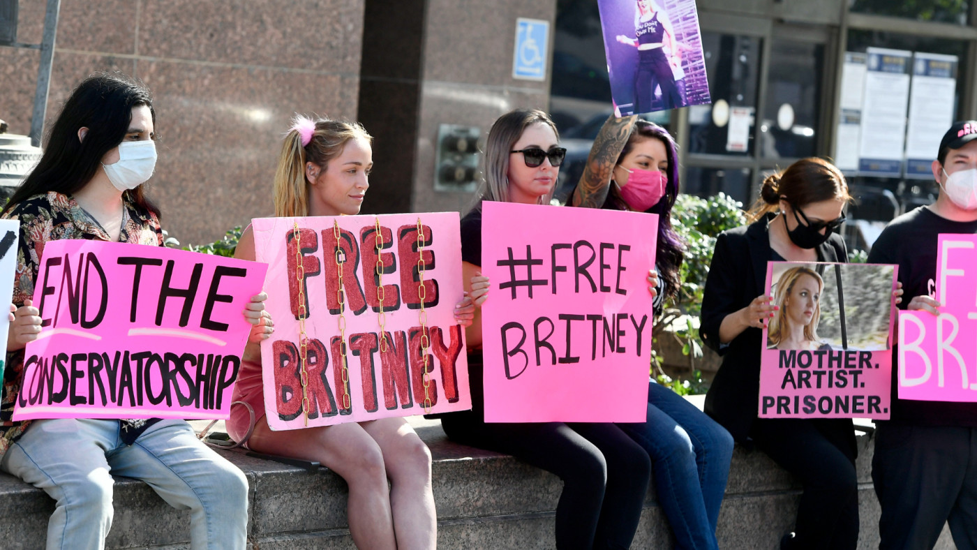 Supporters hold signs at the hearing for the Britney Spears Conservatorship.