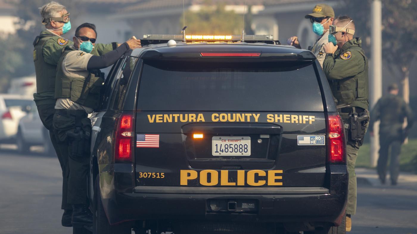 Sheriff's deputies evacuate a threatened neighborhood