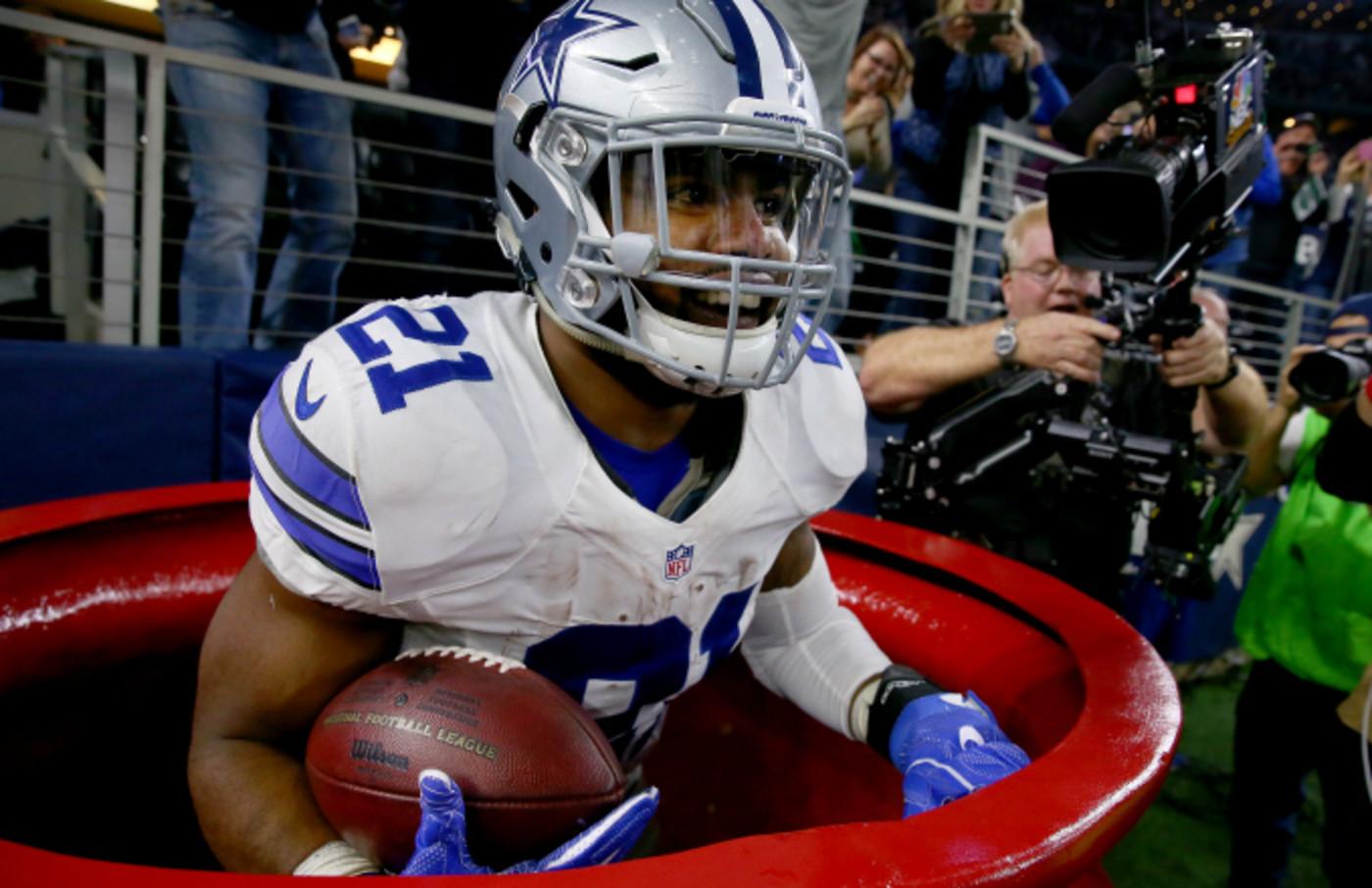 Ezekiel Elliott #21 of the Dallas Cowboys celebrates after scoring a touchdown