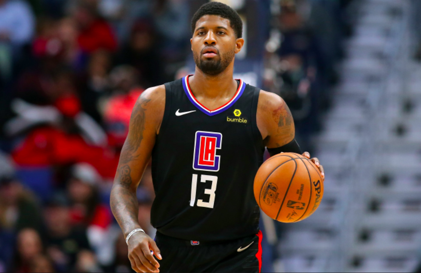 Paul George #13 of the LA Clippers reacts during a game