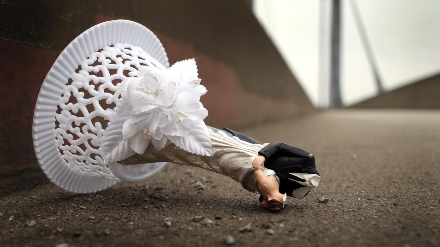 Broken wedding cake topper