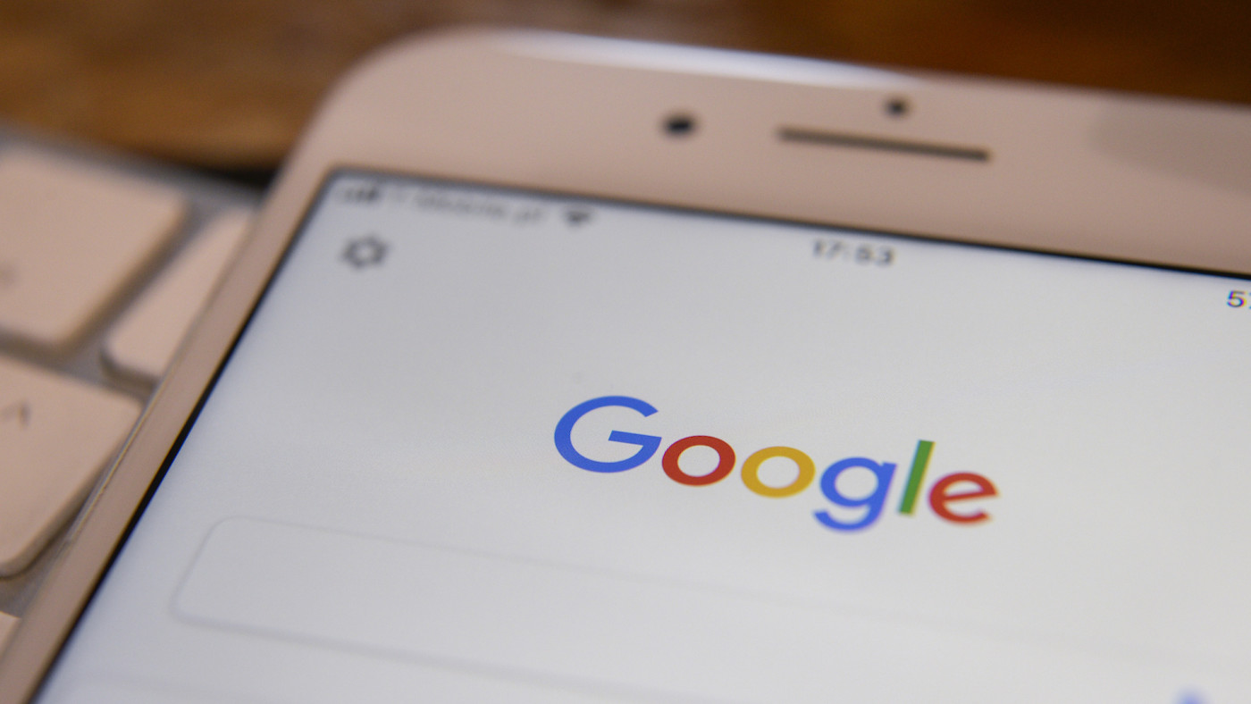 The Google search application is seen running on an iPhone.